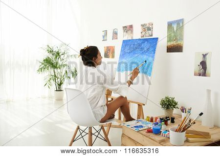 Female artist working at studio
