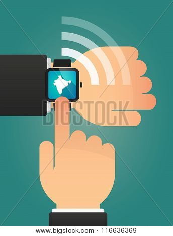 Hand Pointing A Smart Watch With  A Map Of India