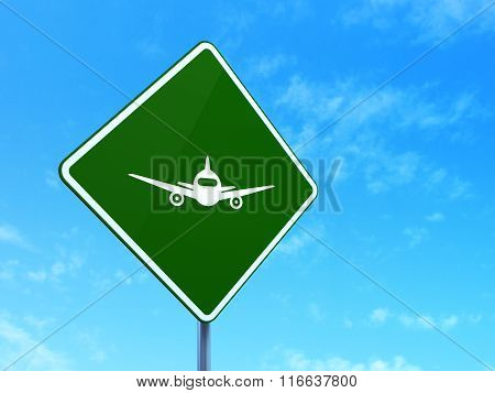 Tourism concept: Aircraft on road sign background