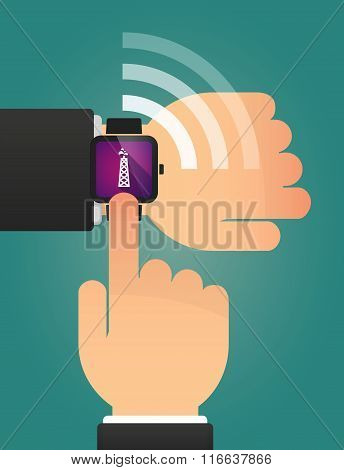 Hand Pointing A Smart Watch With An Oil Tower