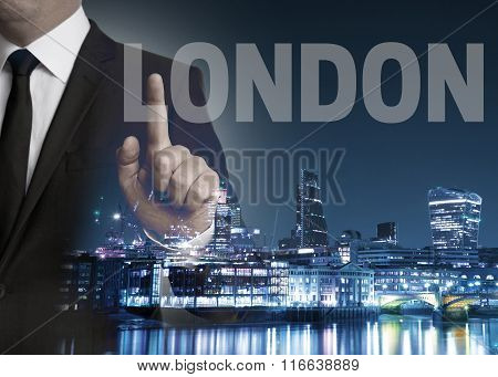 London Skyline At Night With Businessman Concept