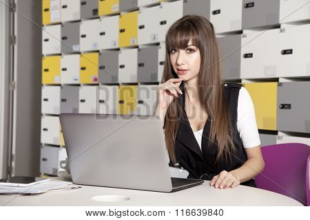 business concept - portrait of a beauty young adult attractive pretty brunette businesswoman in office