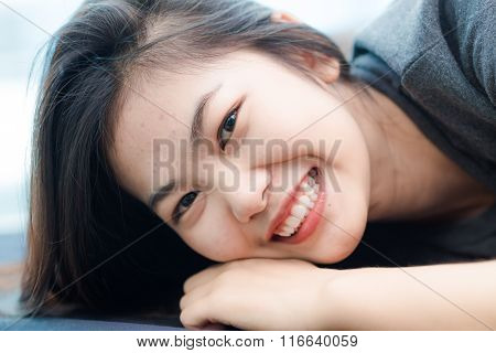 Fashion Photo Of Beautiful Young Asian Woman Lying On The Bed