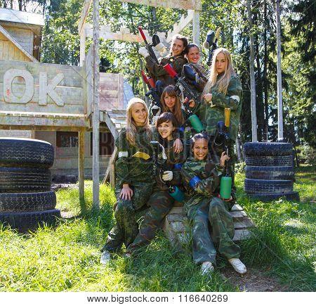 Group Portrait Of Female Models Posing In Military Uniform