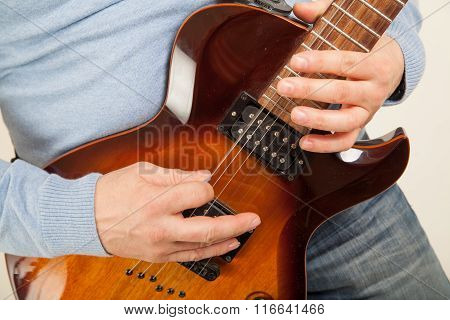 Close Up Of Guitar Player Playing