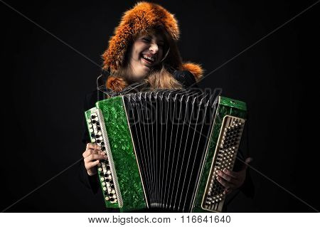 emotional woman in fur hat playing the accordion