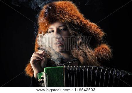 beautiful woman in fur hat with accordion in cigarette smoke