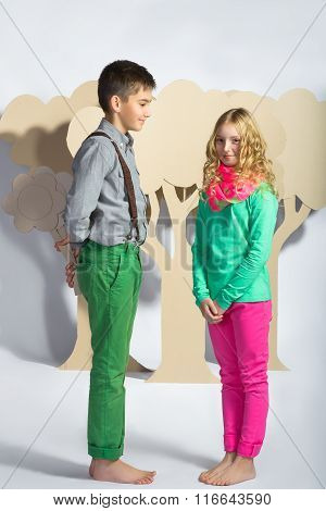 Love concept. Couple of kids. boy gives a girl cardboard flowers
