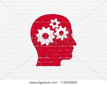 Education concept: Head With Gears on wall background