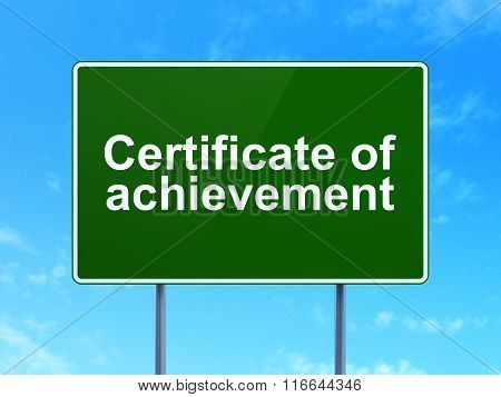 Education concept: Certificate of Achievement on road sign background