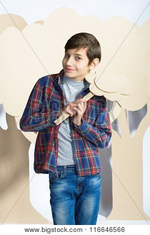 Lover Boy holding a cardboard flower. Love concept