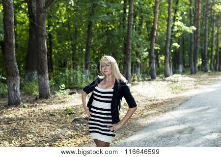 The Beautiful Woman The Blonde Walks In Park