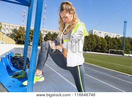 Young Sportswoman Stretching And Preparing To Run