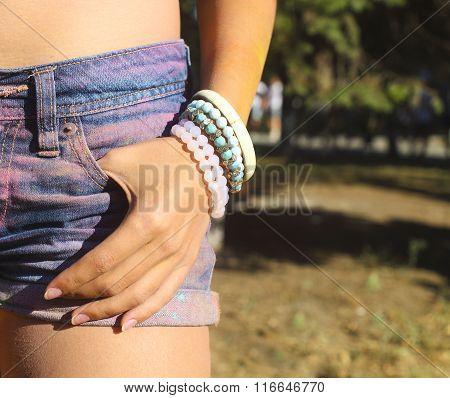 Girl Wearing Bracelet In Denim Shorts At The Festival Of Color Holi