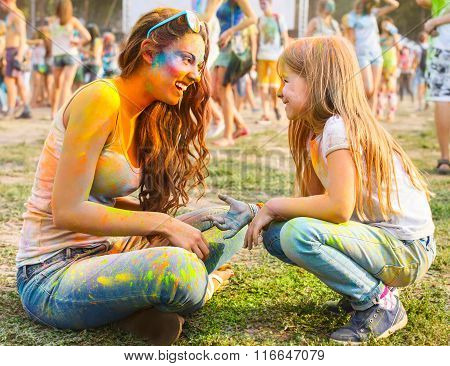 Happy Mother With Little Daughter On Holi Color Festival