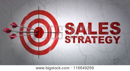 Advertising concept: target and Sales Strategy on wall background