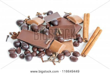 Cracked Chocolate Bar  And  Spices Isolated On White. Selective Focus