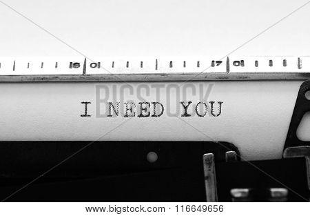 Typewriter. Typing Text:  I Need You