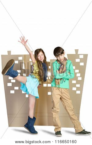 Love concept. sad boy and happy girl standing on background of cardboard city