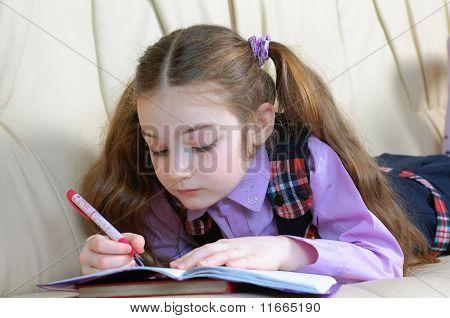 School Girl Doing Homeworks