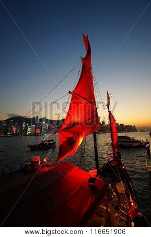 HONG KONG - JANUARY 25, 2016: The Aqua Luna stop at Tsim Sha Tsui. The Aqua Luna, known in Cantonese as the Cheung Po Tsai, is a Chinese Junk operating in Victoria Harbour, Hong Kong