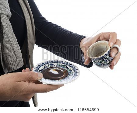 Empty cup of black coffee with coffee sediment, traditionally using for fortune telling, with copy-space