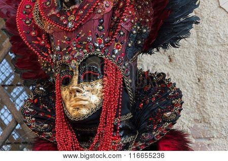 Masked man at Venice Carnival