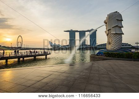 Singapore City And Merlion With Sunrise