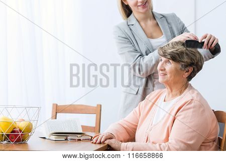 Granddaughter Combing Grandma's Hair