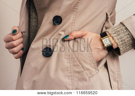 Woman Put Her Hand In Coat Pocket
