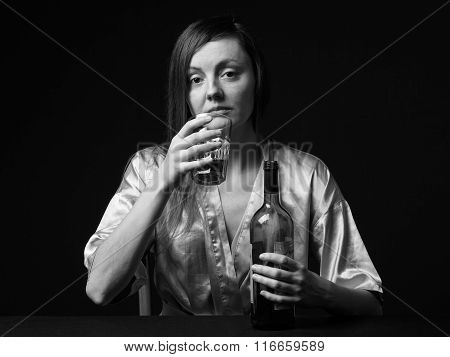 Alcoholism. Young Woman Is Keeping A Bottle And A Wineglass