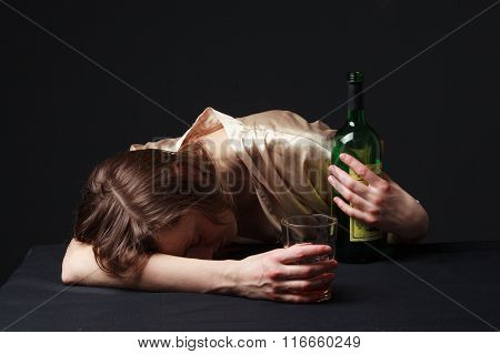 Alcoholism. Young Woman Is Sleeping On The Table