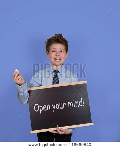 Open your mind concept. Boy with Blackboard Slate on Blue Background.