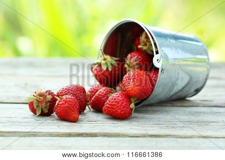 Strawberries Berry In Bucket On Grey Wooden Background