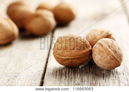 Walnut On A Grey Wooden Table