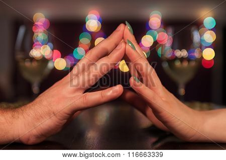 Couple Holding Hands During Romantic Dinner
