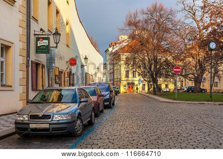 PRAGUE, CZECH REPUBLIC - DECEMBER 10, 2015: Cobblestone street in old town of Prague -  popular tourist destination, capital and largest city of Czech Republic and fifth most visited European city.