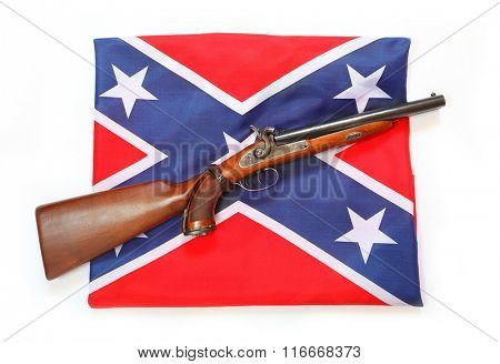 Confederate style cavalry percussion shotgun on confederate flag. Confederate guerrilla using this weapon during the American Civil War.