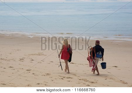 Fishermen And Woman With Net In The Early Morning On Beach , India