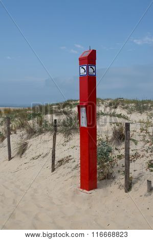 The Isolated English Word Sos On Red Sign To Call On The Beach