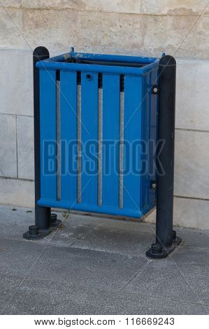 Blue Bin In The Street , Stone Wall Isolated