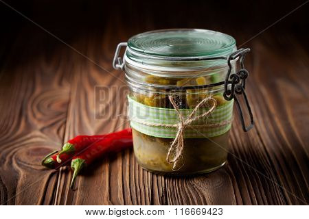 Natural diy pickles with chilli and garlic in a jar