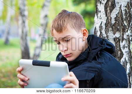 Sad Teenager With Tablet Outdoor