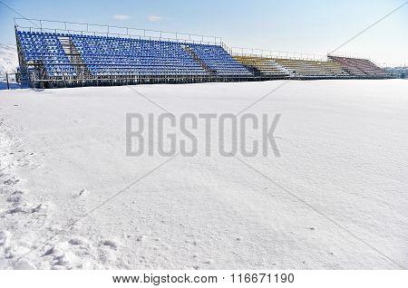 Empty Tribunes On A Stadium After Heavy Snowfall