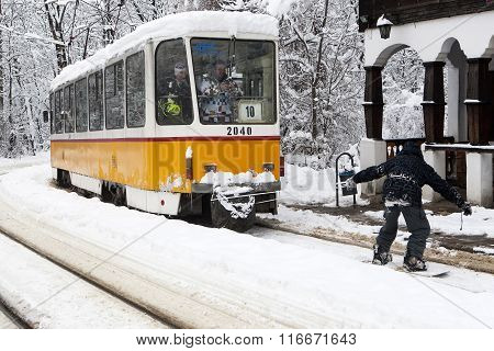 Extreme Snowboard Ride Behind A Tram In Sofia