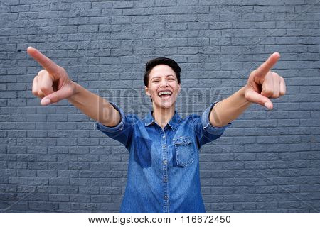 Happy Young Woman With Pointing Fingers