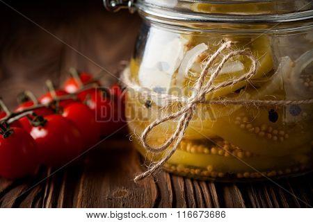 Natural diy marinated green tomatoes in a jar