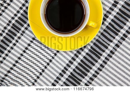 Yellow  Cup Of Coffee And Arab Scarf On A Table