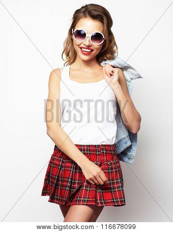 Lovely student girl wearing short skirt