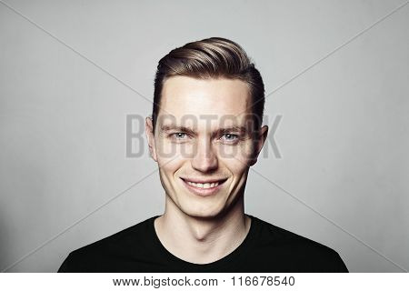 Portrait Of Young Cheerful Man Looking At Camera